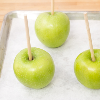 apples with sticks in them