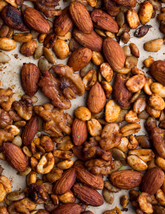 Close-up of roasted mixed nuts on a baking sheet