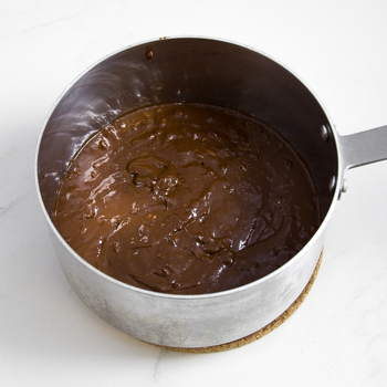 A saucepan of chocolatey barbecue sauce