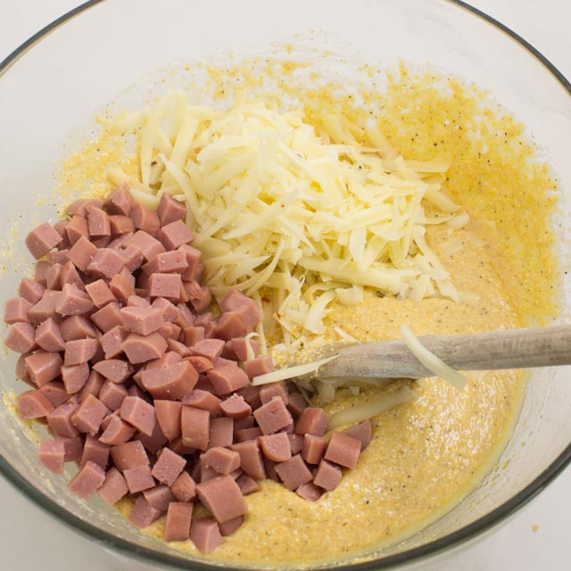 batter with hot dogs