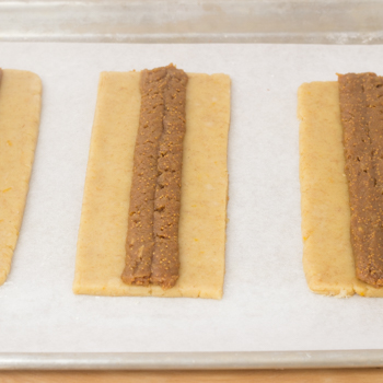 Filing piped into the centre of each rectangular dough piece.