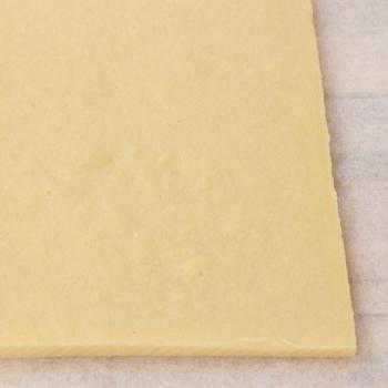Polenta on a cutting board.
