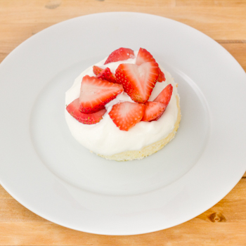 sponge cake with strawberries and cream in the centre.