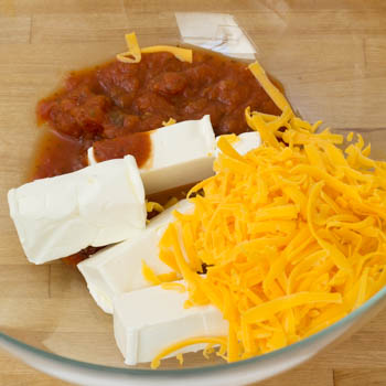cream cheese, salsa, cheddar, and margarine in a bowl