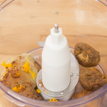 Food processor mixing together figs and the rest of the ingredients.