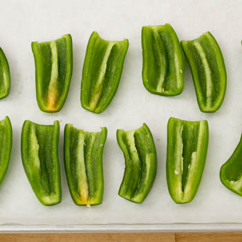 sliced jalapenos on a tray