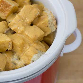 pour liquid over bread cubes