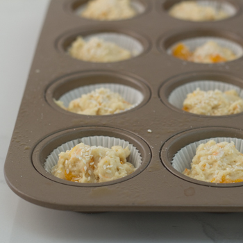 Muffin tins filled with dough