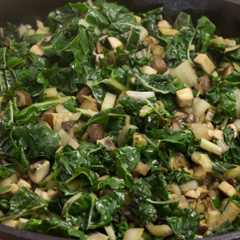 green and veg in pan