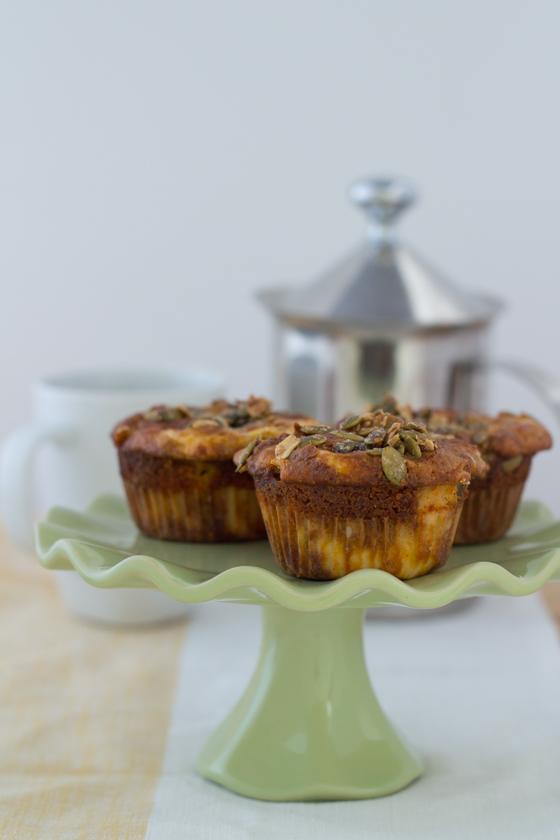 Pumplin cheesecake muffins served on a green plate.