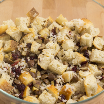 cubed bread with various ingredients in bowl