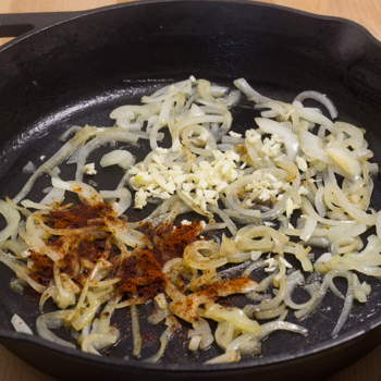 onions and spices in skillet
