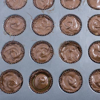 add chocolate to muffin tin