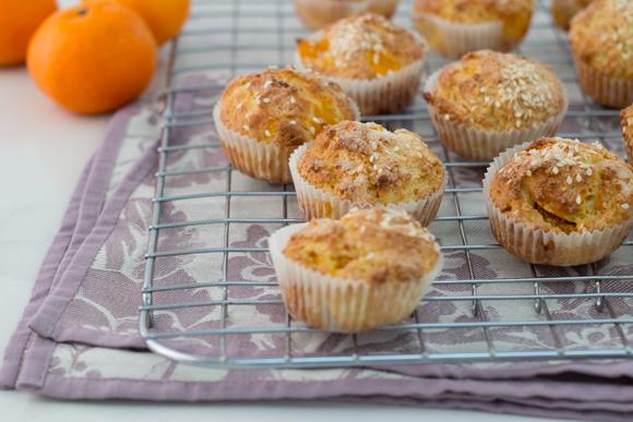 Mandarin sesame muffins on cooling rack