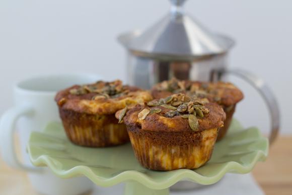 Pumpkin cheesecake muffins on a green platter